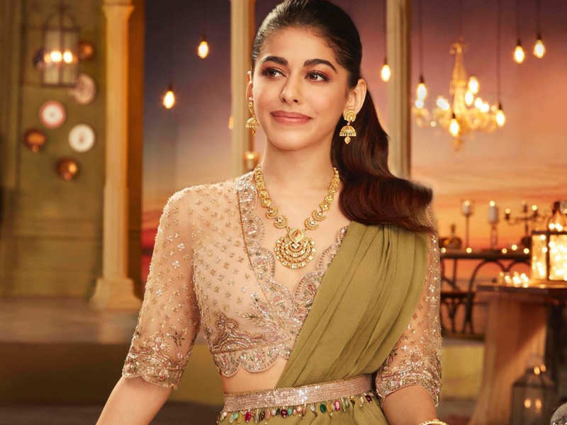 Alaya F's green ruffled sari and champagne blouse cost a little less than INR 1 lakh and it's a smashing combo