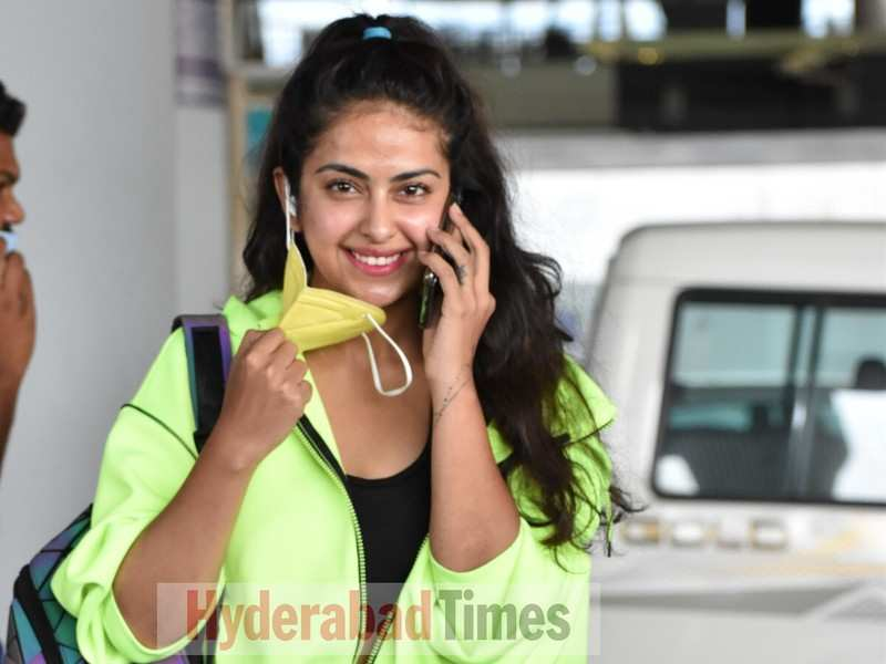 Spotted: Avika Gor spreads some love and smiles as she arrives in Hyderabad in a neon green jacket