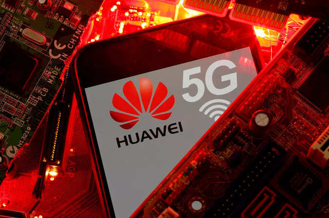 A smartphone with the Huawei and 5G network logo is seen on a PC motherboard in this illustration picture taken January 29, 2020. REUTERS/Dado Ruvic/File Photo