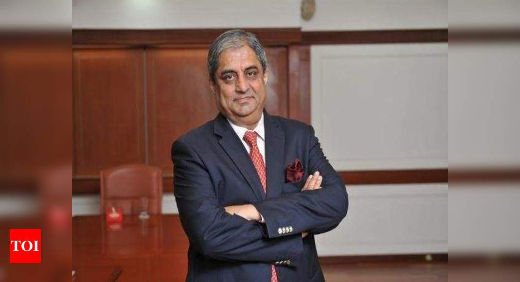 Aditya Puri backs corporates in banking, says no harm in trying it – Times of India