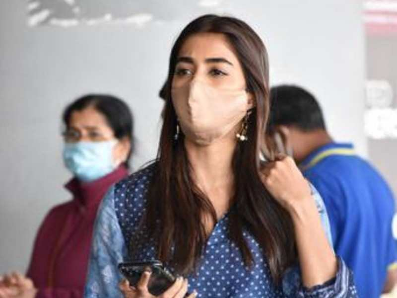 Spotted: Pooja Hegde arrives in Hyderabad in a beautiful indigo fusion dress with chandelier earrings