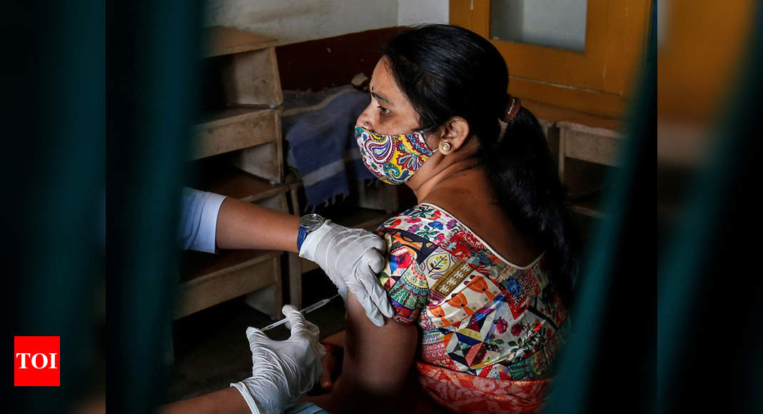 Tables turn as India's female health workers get Covid jab   India News – Times of India