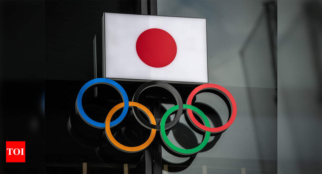 Japan PM 'determined' to hold Olympics despite cancellation report