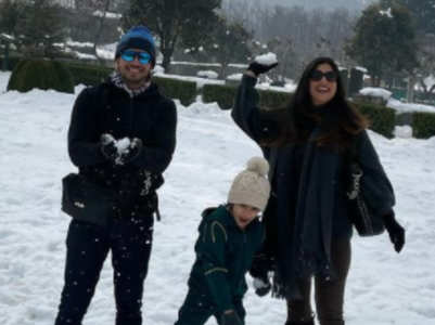 Arjun enjoys snow time with wife and son