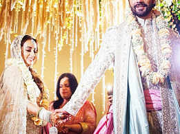 Varun-Natasha shone bright in their wedding outfits