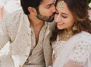 Mehendi: Varun & Natasha twinned in white