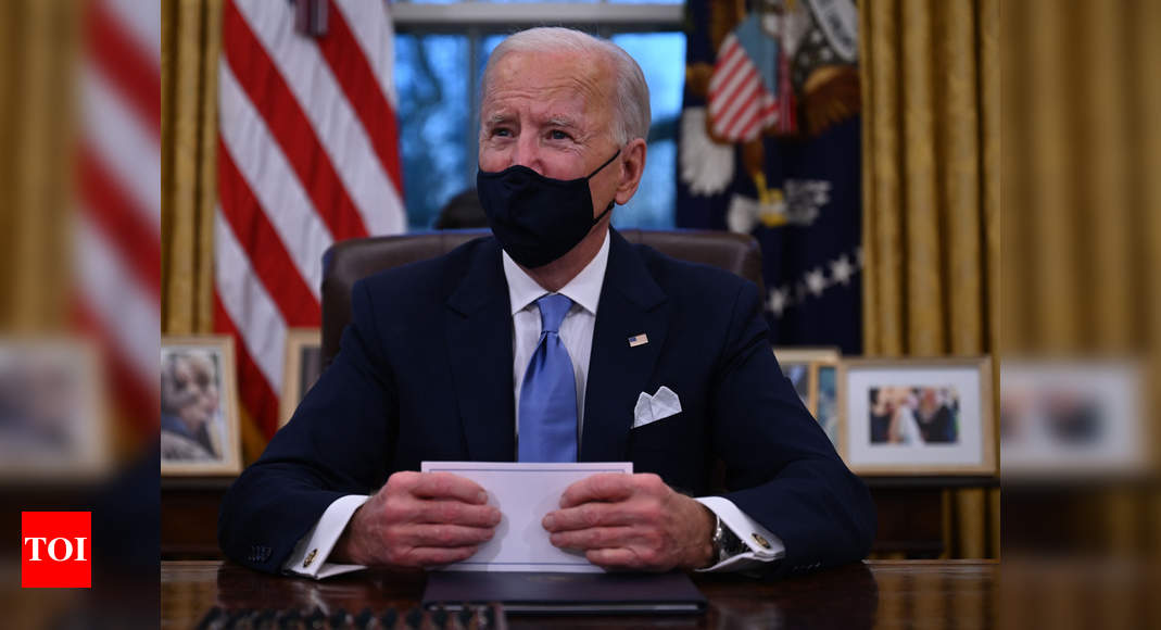 Biden, in first call with Putin, presses on Navalny, treaty - Times of India