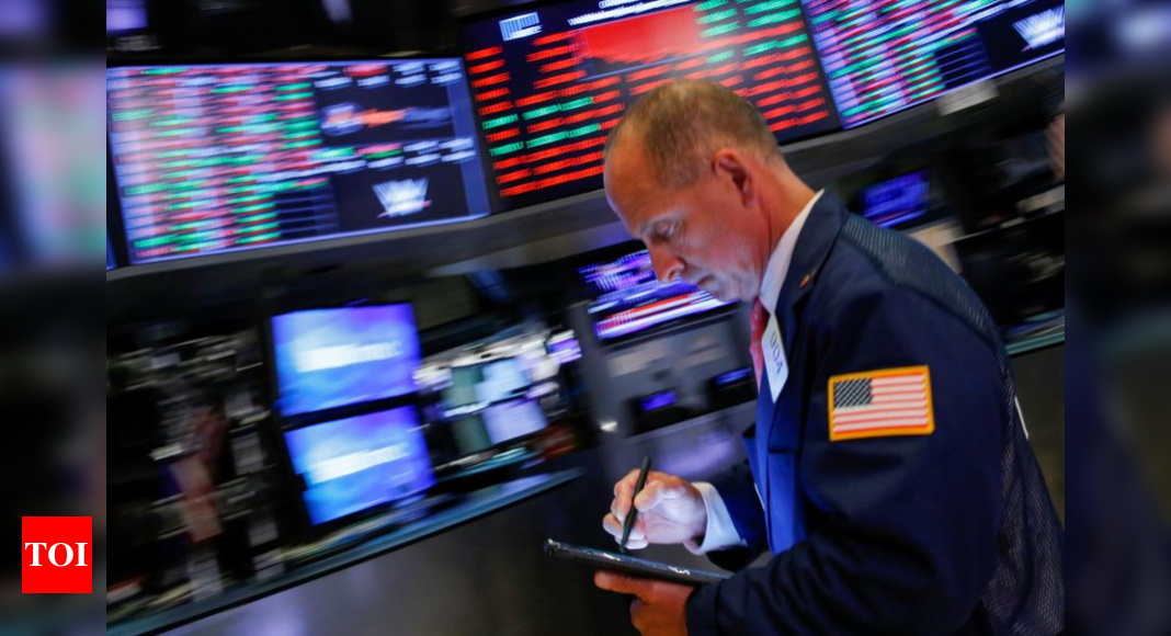 US stocks hit record highs, bitcoin surges after Tesla news - Times of India