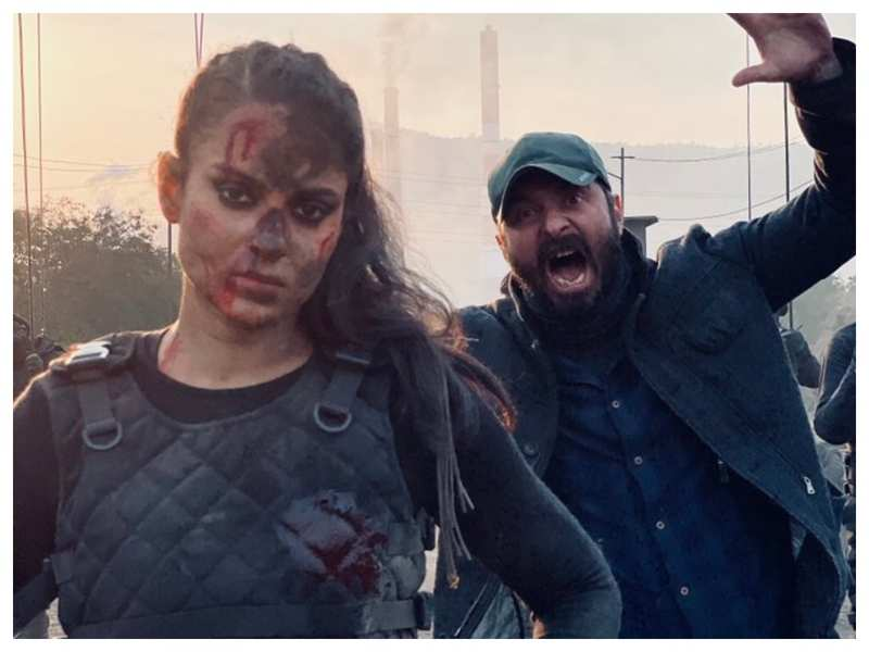 THIS picture of director Razneesh Ghai photobombing Kangana Ranaut on the sets of 'Dhaakad' is simply unmissable