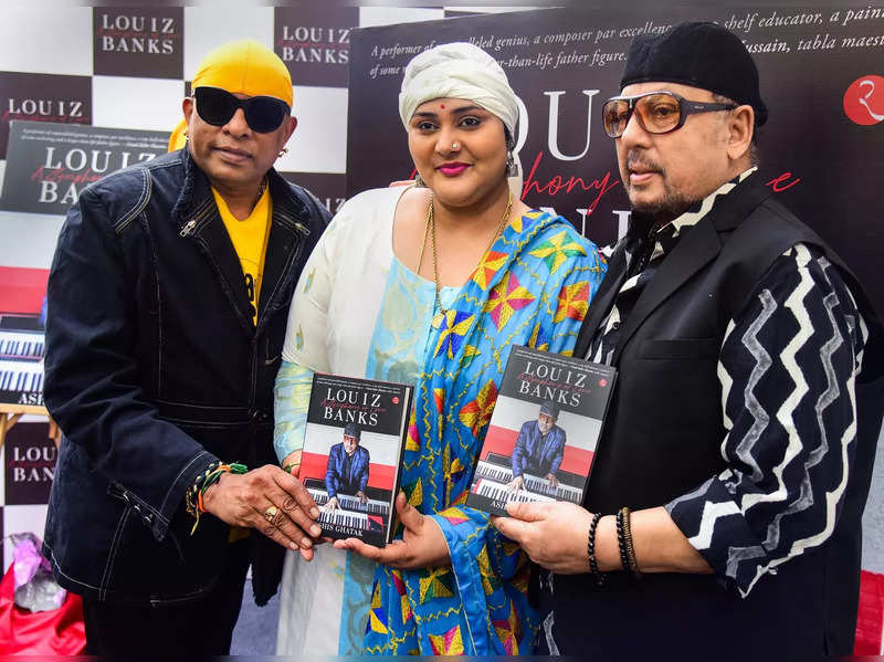 Jazz pianist Louiz Banks (R) poses for photographs during the release of the book, 'Louiz Banks- A Symphony of Love', an biographical account of the musician, during his 80th birthday celebrations in Mumbai.Photo)(