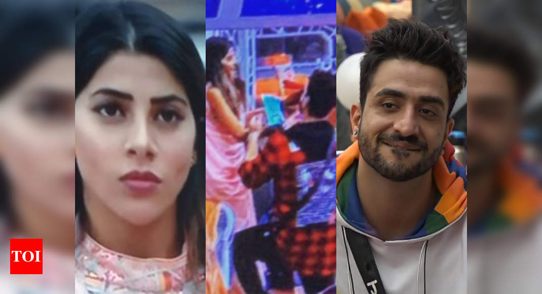 """Bigg Boss 14: Aly Goni tries to cheer up an upset Nikki Tamboli; goes down on his knees and wishes her """"H - Times of India"""