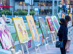 Art lovers attend an exhibition at Cyber Hub
