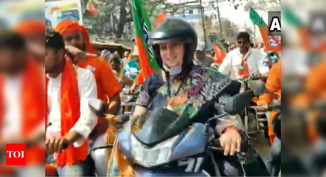 After Mamata, Smriti Irani rides scooty to lead BJP rally in West Bengal