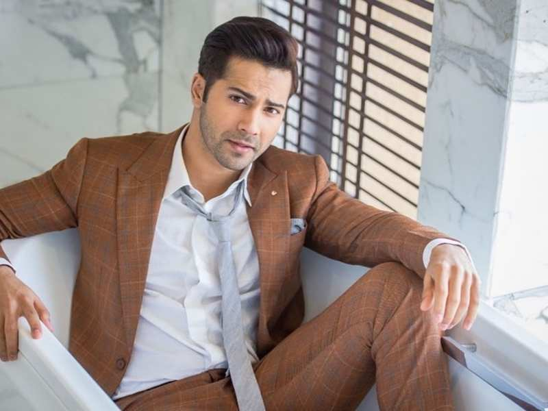 Varun Dhawan looks dapper and handsome in a plaid suit with a grey tie