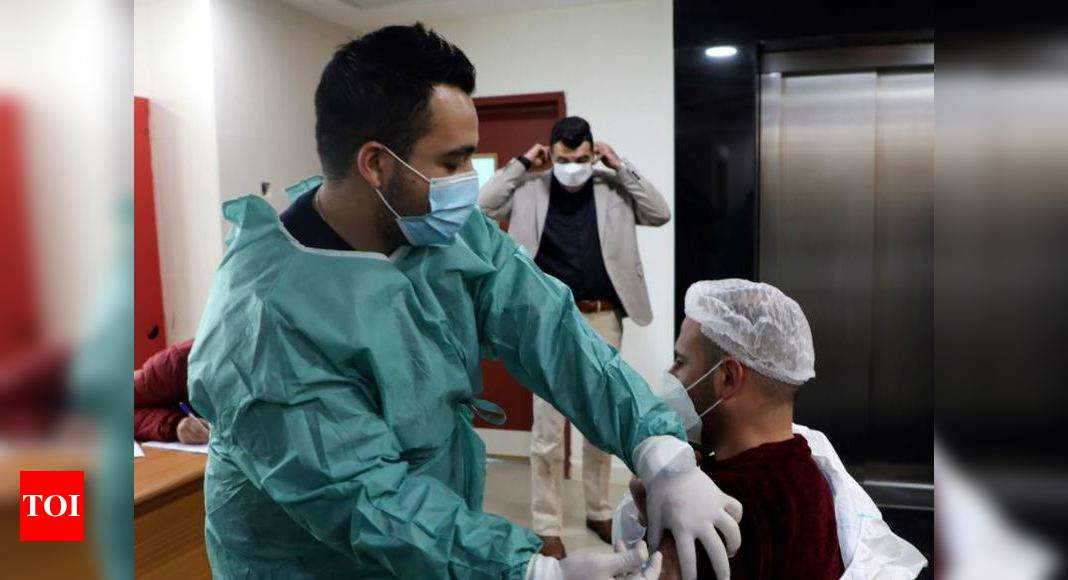 Israel to vaccinate Palestinian labourers against Covid-19 – Times of India
