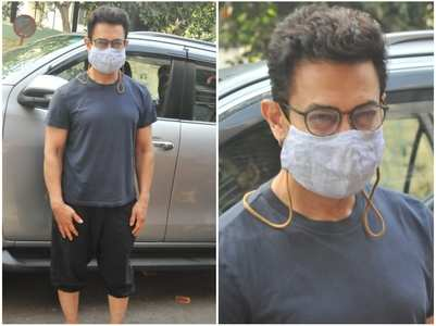 Aamir Khan poses for pics outside a salon