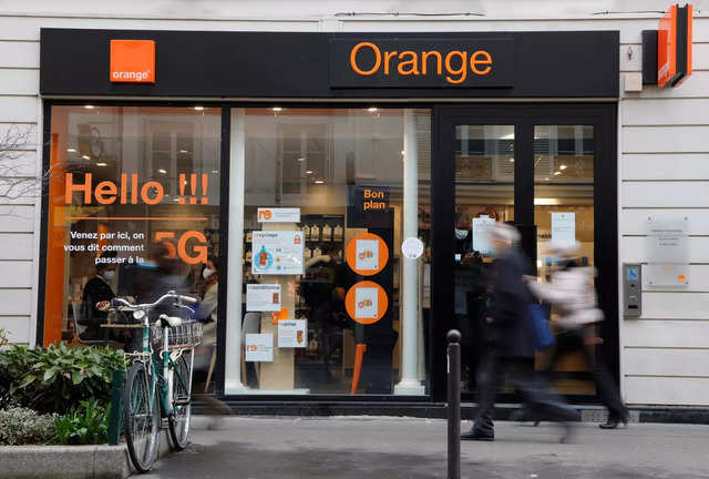 People walk past a store of the French telecoms operator Orange in Paris, France, February 16, 2021. REUTERS/Sarah Meyssonnier