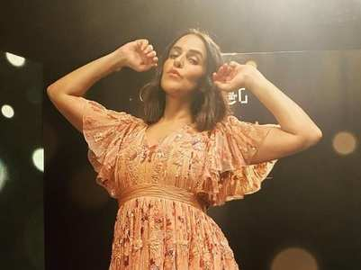Neha Dhupia's style is about flares and prints