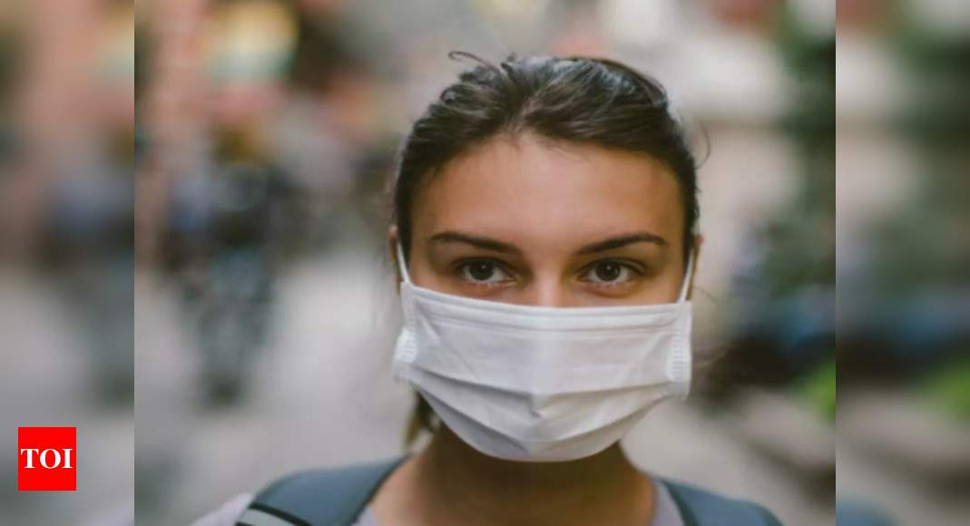Coughing? Wear a multilayered mask, say IISc scientists - Times of India