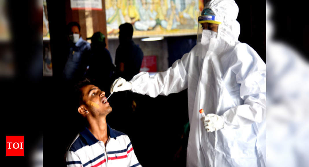Covid-19: India records 18,711 new cases, 100 fresh fatalities | India News – Times of India