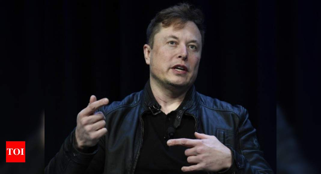 Tesla investor sues Elon Musk, claims tweets violate SEC settlement - Times of India