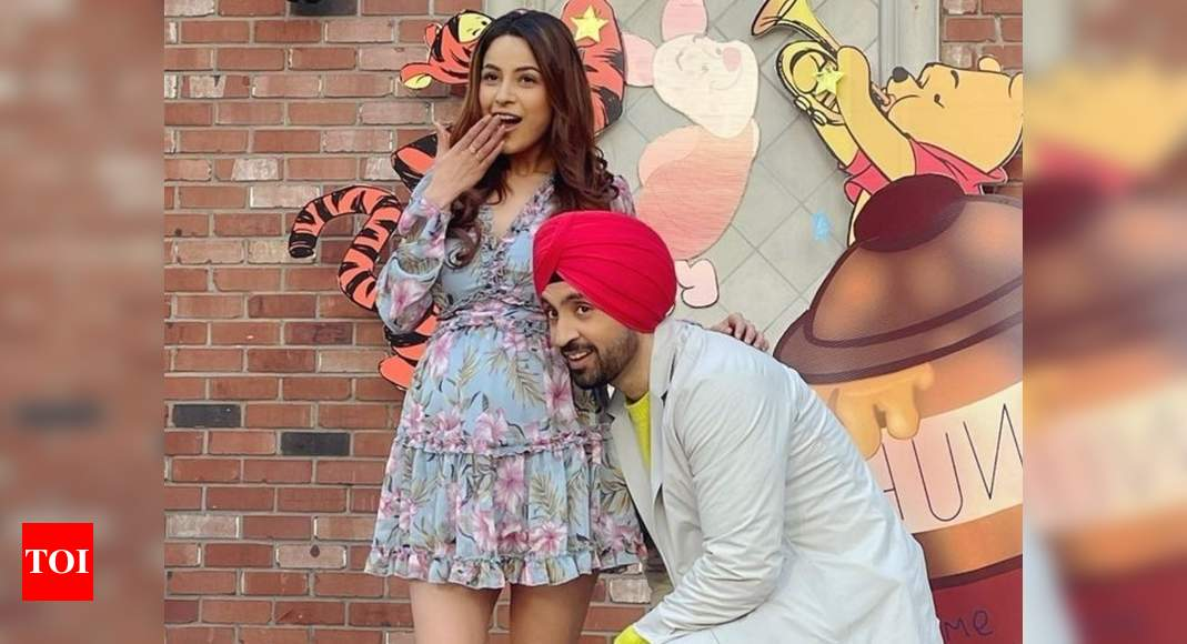 Bigg Boss 13's Shehnaaz Gill flaunts her cute baby bump with Diljit Dosanjh in these pictures from Canada - Times of India