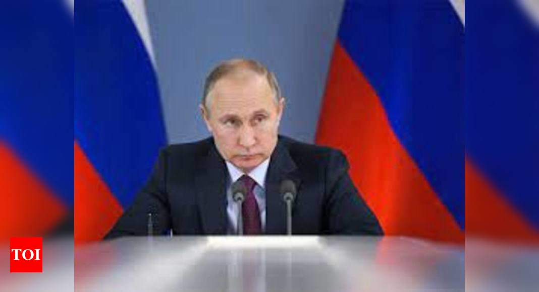 Russian President Putin felt minor side effects from Covid-19 vaccine - Times of India