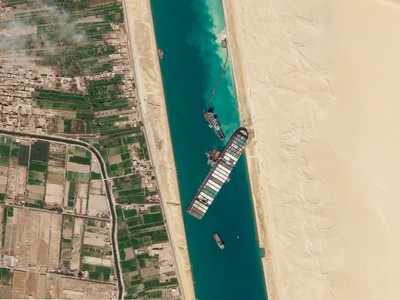 Container ship stranded in Suez Canal re-floated