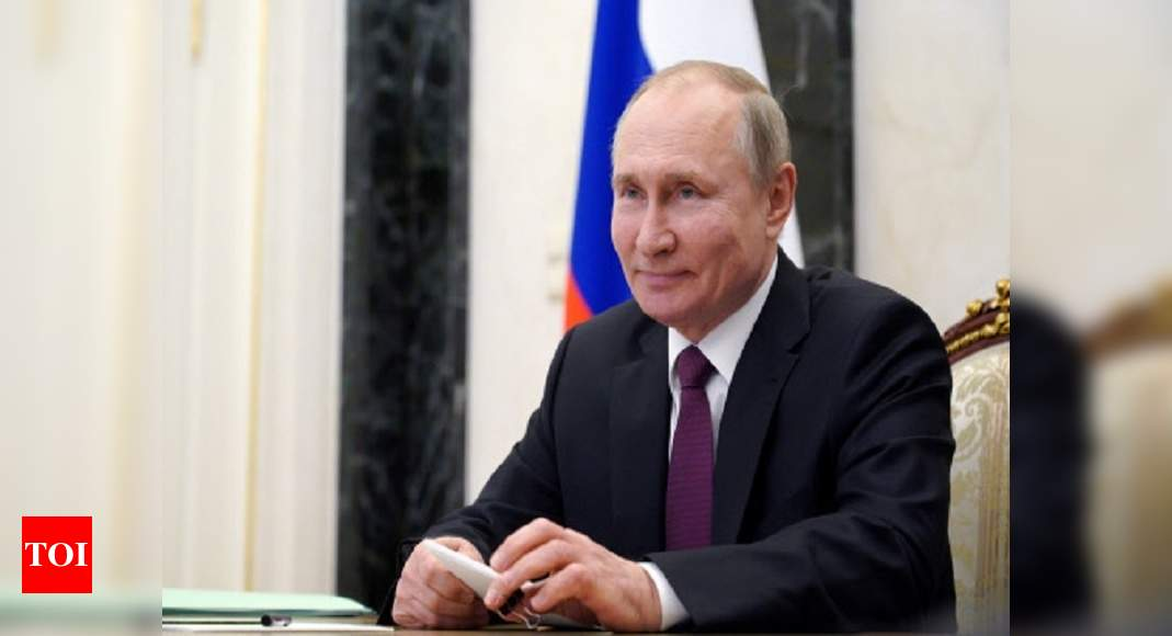 Vladimir Putin signs law that could keep him in Kremlin until 2036 – Times of India