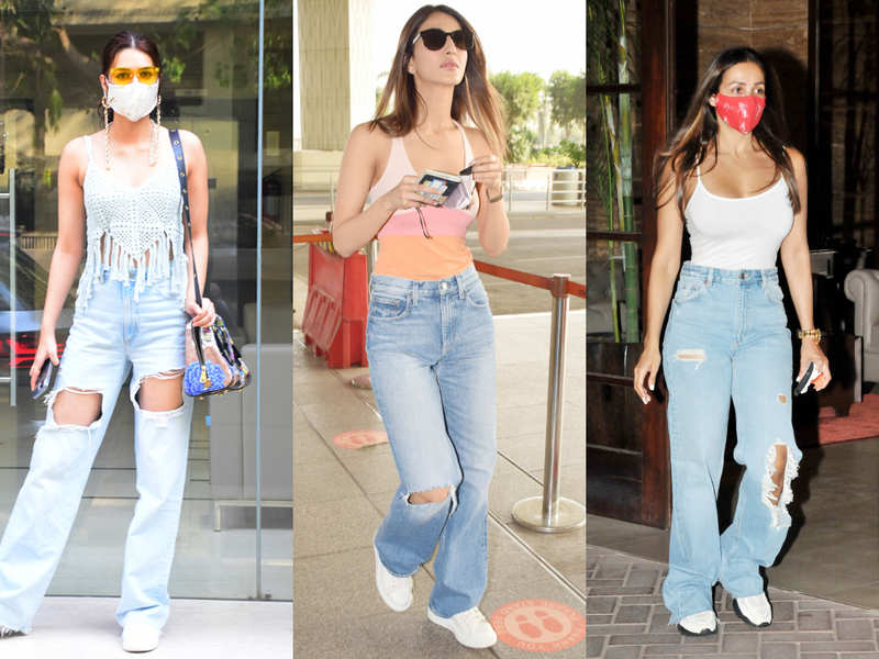 Celebs are styling their tank tops with loose and distressed jeans this season