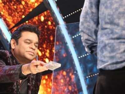 AR Rahman gives his autograph to Ashish