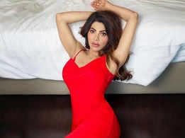Nikki looks stunning in a fiery red dress