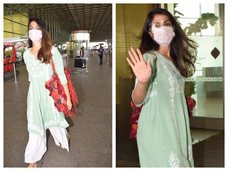 Photos: Rhea Chakraborty gets snapped by the paparazzi at the airport as she flies out of the city