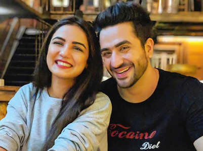 Aly Goni and Jasmin enjoy a game of ludo