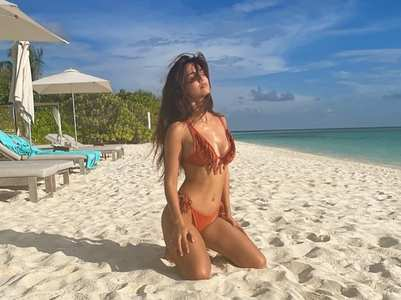 Disha Patani slays in orange fringed bikini