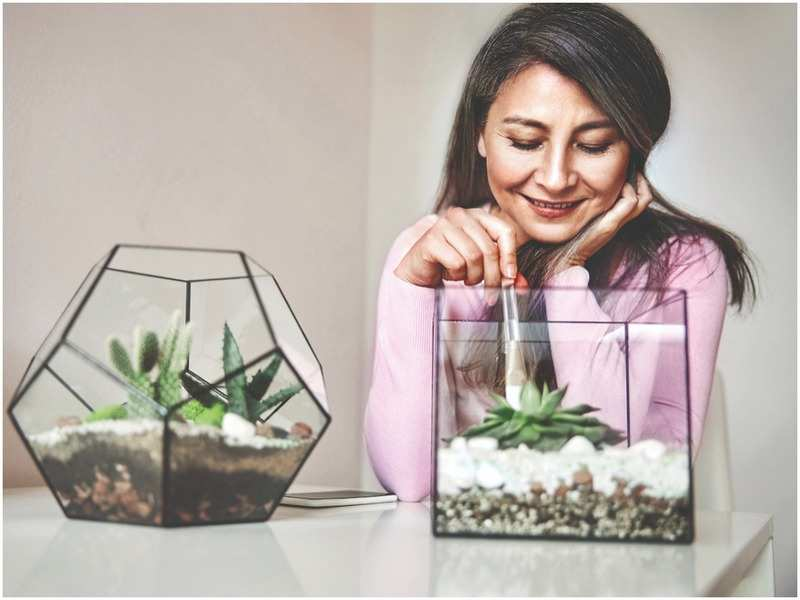 A lady taking care of terrariums (pic credit: iStock)