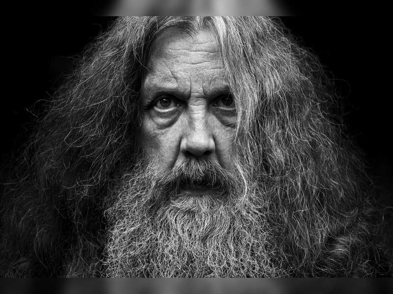 "This photo provided by Bloomsbury Publishing shows Alan Moore. The celebrated British author known for ""V for Vendetta"" and ""Watchman"" among other works has a deal with Bloomsbury for the story collection ""Illuminations"" and a five-volume fantasy series, ""Long London."" In a statement Monday, May 3, 2021, Moore said he was ""bursting with fiction, bursting with prose"" and thanked his publisher for its commitment to ""expanding the empire of the word."" (Bloomsbury Publishing/Mitch Jenkins via AP)"