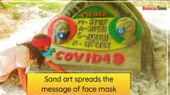 Sand art spreads the message of face mask