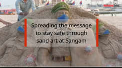 Spreading the message to stay safe through sand art at Sangam