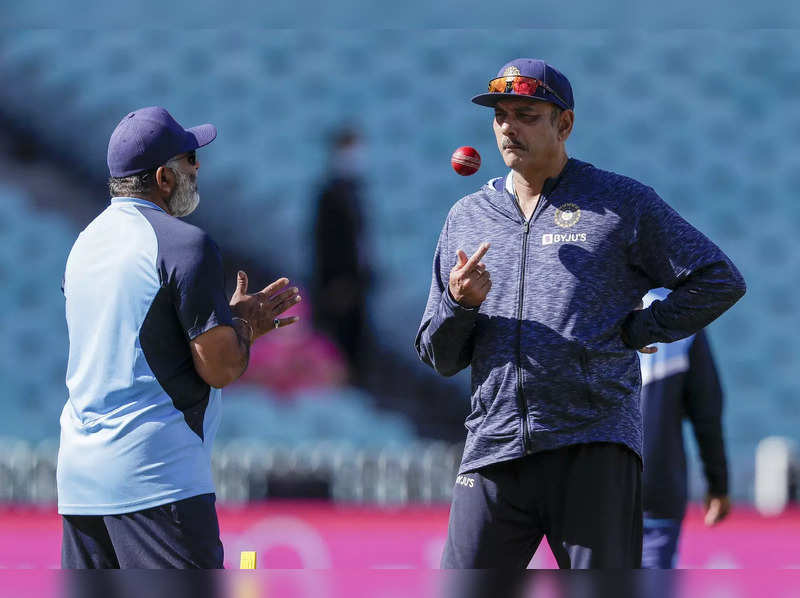 Sydney: Indian team coach Ravi Shastri, right, talks with a colleague ahead of play on day three of the third cricket test between India and Australia at the Sydney Cricket Ground, Sydney, Australia. (AP Photo/Rick Rycroft)(