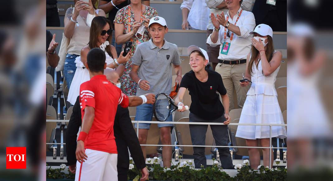 Djokovic gifts his racquet to the boy who was 'coaching' him