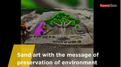 Sand art with the message of preservation of environment
