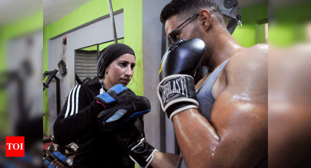 Woman trains men to box in Egyptian agricultural heartland | Boxing News – Times of India