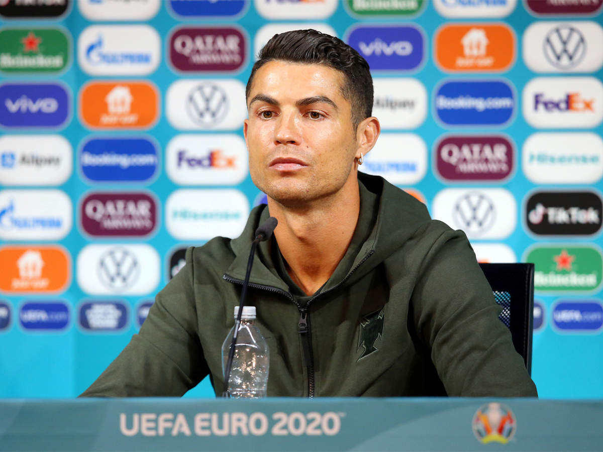 Drink water': Cristiano Ronaldo removes Coca Cola bottles at Euro press conference | Football News - Times of India