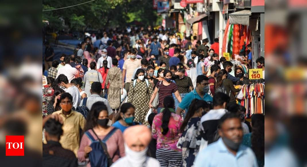 Covid-19: Precautions key, warns govt as positivity rate declines to 4.8% | India News – Times of India