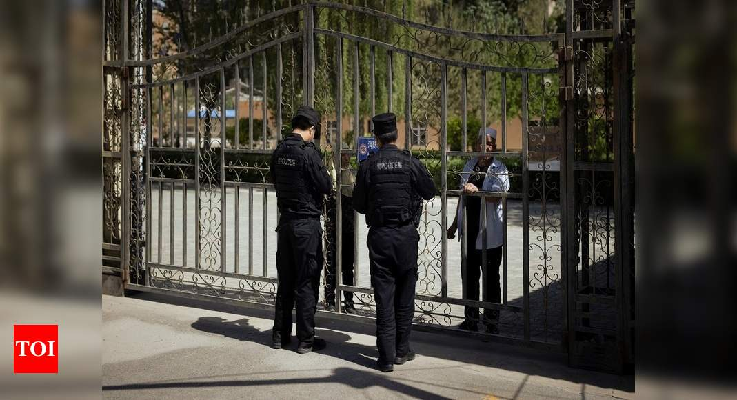 In China's new Xinjiang: patriotic tourism, riot police and caretakers