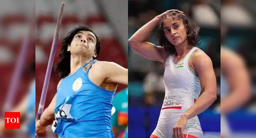 SAI allows Neeraj Chopra, Vinesh Phogat to continue training in Europe ahead of Olympics | More sports News – Times of India