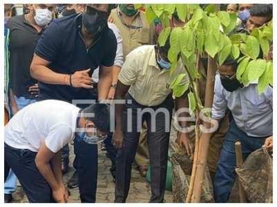 Pics: Ajay Devgn, Yug plant trees in city