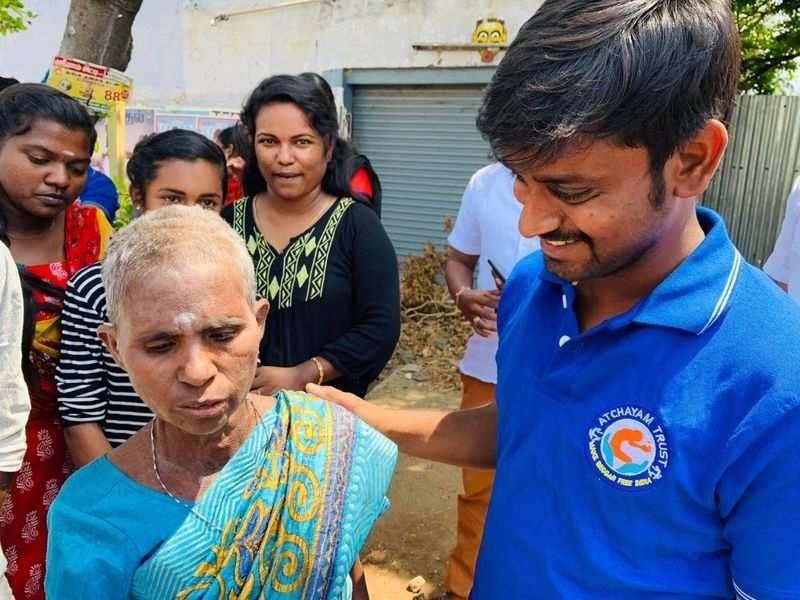 Naveen Kumar with a rehabilitated beggar.
