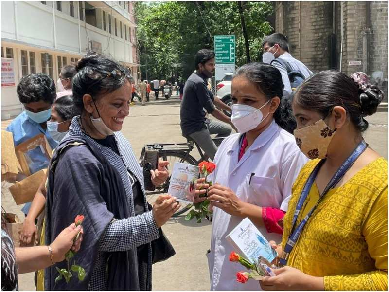 Handing out flowers and other treats to the doctors on Doctor's Day